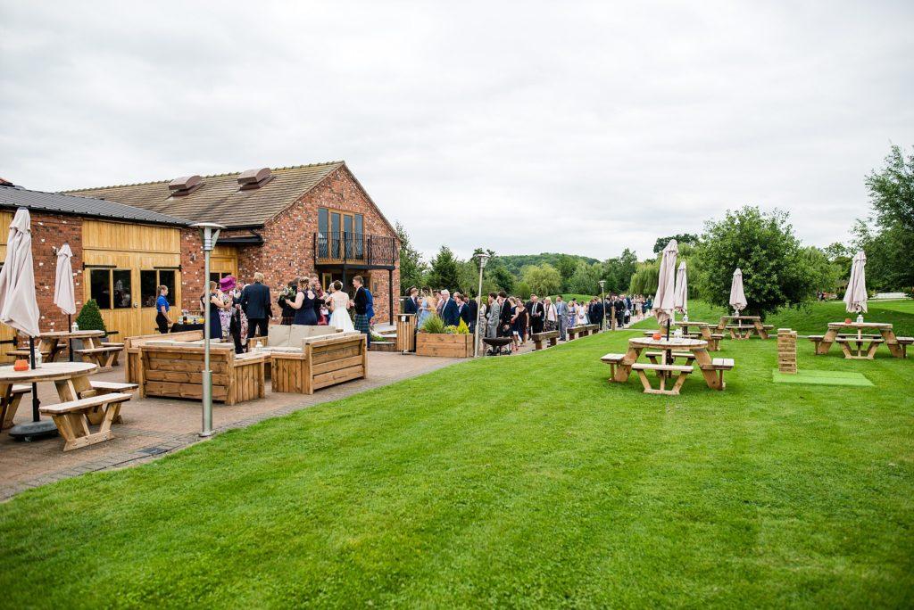 guests mingle at outdoor wedding at Wootton Park