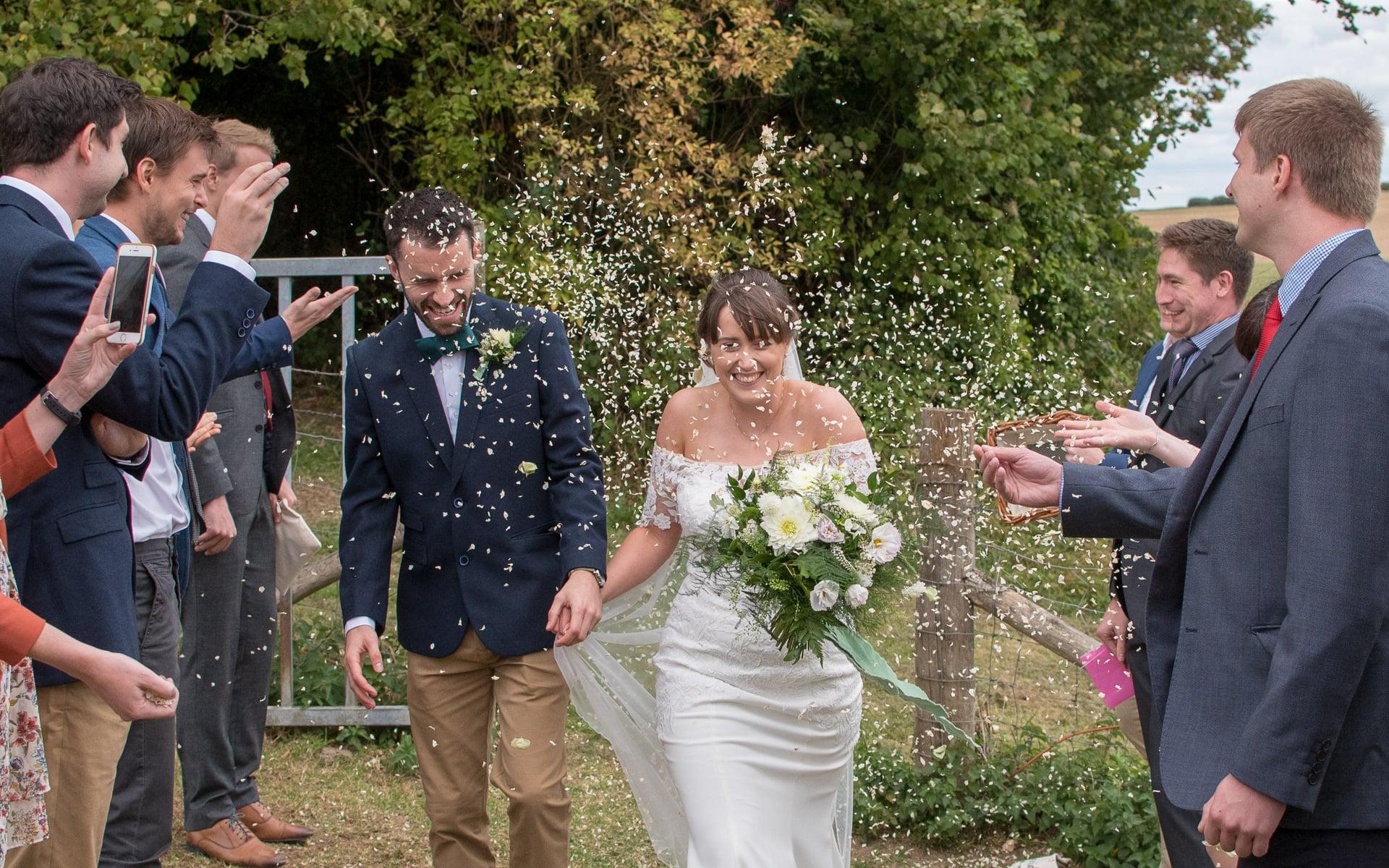 Wedding confetti photo of couple at an outdoor wedding